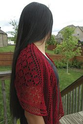Ruby Jewels is a crescent shaped lace shawlette knitted in fingering weight yarn. It is knitted from the top down with all increases at the sides. There is no central spine, but instead the central motif is flanked by a lace pattern which radiates outwards. The applied, beaded, edging means no long bindoff! This shawlette is recommended for intermediate knitters.
