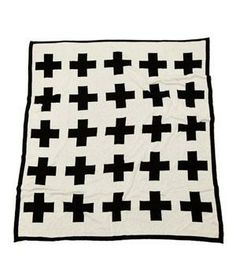 Swiss Cross Throw: If sipping cider on a Swiss mountainside is only a dream, this cross-design throw is the next best thing.