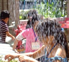 """Kids can enjoy the outdoors at LICM's Our Backyard gallery. They can race toy boats and watch the water cycle in action using different pumps, gutters and drains. They can even create their own on-demand """"rain."""""""