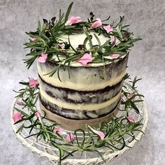 Semi naked chocolate cake with fresh herbs and dried petals