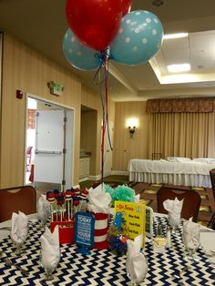 Finished off the table with a Dr. Suess hat. I took a large broth can and covered it with red and white felt. Taped some balloons to the inside to finished off the look of the table