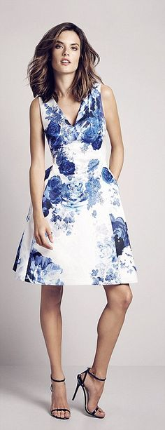 Mum-of-two Alessandra models a chic A-line dress with a blue floral design