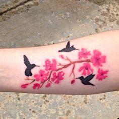 Watercolor Cherry Blossom Hummingbird Tattoo by Robert Winter.