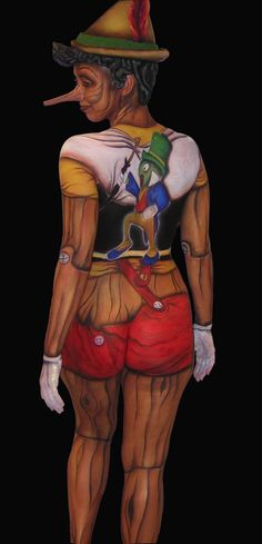 why would you want to get naked and paint yourself in paint and then choose the most unglamourous style of doing it as pinocchio and put a big stick on your nose freaky choices for costume fancy dress #Bodypaint