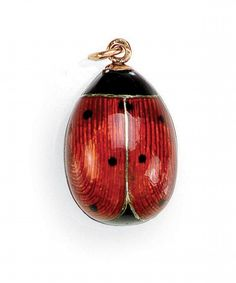 A FABERGÉ ENAMEL EGG PENDANT, WORKMASTER FEDOR AFANASSIEV, ST PETERSBURG, CIRCA 1900 -enamelled as a ladybird in translucent red and opaque black, the reverse in translucent blue, gold suspension ring, restorations, 56 standard. via Sotheby's.