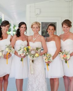 The bride's five attendants wore white Bill Levkoff dresses from Trudy's Brides and Anthropologie earrings.