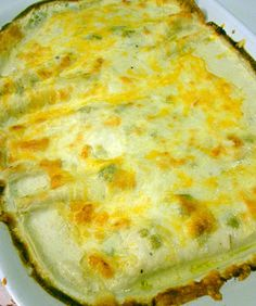White Chicken Enchiladas with Green Chili and Sour Cream sauce- our family's favorite dinner!