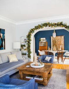 Vintage modern Christmas decor tour. Gorgeous home with lots of blues decorated with fresh garland and collection of cone trees.