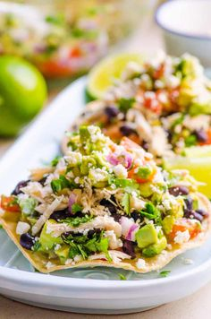 Healthy Mexican Chicken Tostadas Recipe for a 20 minute weeknight dinner. Crunchy tortillas (quick homemade recipe included) topped with shredded chicken, beans and easy guacamole. SO GOOD!