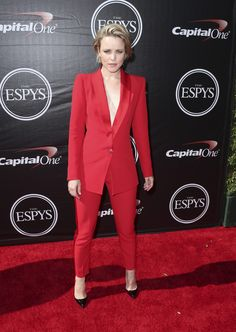 Rachel McAdams - a Spring in a bright red suit. Jacket is way too long for her. Makes her legs positively stubby.