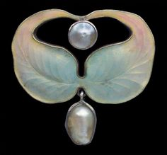 Jugendstil Brooch attributed to Otto Prutscher  Gilded silver Enamel Pearl  H: 3 cm (1.18 in)  W: 3.1 cm (1.22 in)   Marks: 'HL' monogram 'Depose 900''  German, c.1900