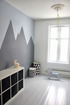 Grey mountains - shown in a kids room, but I'd love to do this in my laundry room, only with chalkboard paint