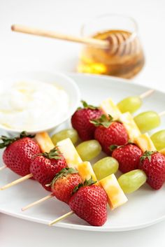 Fruit and Cheese Kabobs  Yield: 12 skewers  Ingredients:  8 Sargento® Reduced Fat Colby-Jack Cheese Snacks  24 green seedless grapes  24 small strawberries  4 oz. low fat vanilla yogurt  honey (optional)