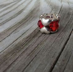 Valentine Crystal Heart Troll Bead Sterling Beautiful, authentic 'Valentine' Troll bead (will fit Pandora) featuring hearts and 3 crystals in red, pink and red/orange. 925 stamped sterling, new without tags. A  lovely addition to your charm bracelet! Troll Jewelry Bracelets