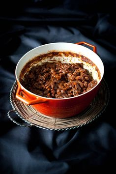 Homemade Baked Beans  1 pound of dry Yellow Eye Beans  4 Cups Cold Water  1/2 tsp Baking Soda  1 Onion, chopped  1/2 pound Bacon, chopped  1 Cup Ketchup  1/2 Cup Molasses  2 tsp Apple Cider Vinegar  1 tsp Liquid Smoke  1/4 Cup Dark Brown Sugar, packed  1 tsp Dry Mustard Powder  1/4 tsp Pepper