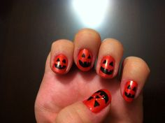 Halloween Nails! A coral orange color of polish. Then used a Sally Hansen nail art pen. Finished with a clear coat. Easy!