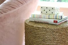 Ashley loved rope-wrapped side tables, but didn't like the idea of buying two for her living room. After some brainstorming, she came up with a cheap solution that: a) met the need for an accent table and b) mimicked the look of woven rope. Although not great for houses with cats, they're an otherwise affordable and stylish alternative.
