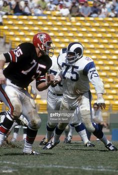 831bd02eb Defensive Tackle Deacon Jones of the Los Angeles Rams looks to get... Nfl  Football ...