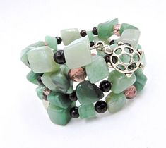 This gorgeous, natural wrap bracelet is made on silver memory wire with genuine natural green Aventurine stone nuggets, glass and crystal accent beads, and silver turtle charm. ★ Return to my main shop page here for more inventory ★ www.etsy.com/shop/bridgetollbeading  ★ Read my