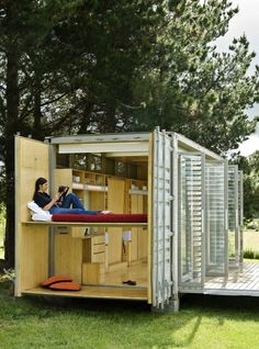 Shipping container turned into expandable camper with porch, bunkbeds, and shower.