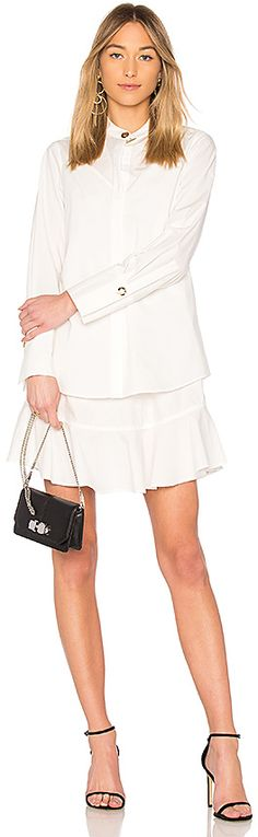 DEREK LAM 10 CROSBY Shirt Dress in White. - size 0 (also in 2,4,6,8) DEREK LAM 10 CROSBY Shirt Dress in White. - size 0 (also in 2,4,6,8) From the workplace to the weekend, DEREK LAM 10 CROSBY's Shirt Dress embodies authentic All-American style. This cotton piece gives the crisp white shirt a feminine touch with a layered slip dress proving the brands signature city-chic aesthetic.. 100% cotton.   #DayDresses #REVOLVE