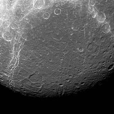 Dione reveals its past via contrasts in this view from NASA's Cassini spacecraft. The features visible here are a mixture of tectonics -- the bright, linear features -- and impact cratering -- the round features, which are spread across the entire surface.  Tectonic features tell the story of how Dione (698 miles or 1,123 kilometers across) has been heated and cooled since its formation, and scientists use those clues to piece together the moon's past.