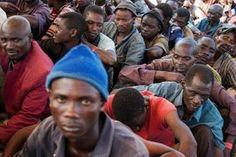 Burundian refugees wait for food at the Lake Tanganyika Stadium in Kigoma, western Tanzania, on May 20, 2015.