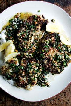 These cauliflower steaks are seared first, then finished in the oven. They're served with a lemon-yogurt sauce and irresistible caper-walnut salsa. Cauliflower Steaks, Roasted Cauliflower, Cauliflower Recipes, Spinach Recipes, Salad Recipes, Ottolenghi Recipes, Yotam Ottolenghi, Good Roasts, Vegetables
