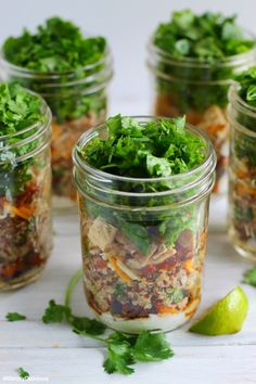 Burrito Bowl Mason Jar Salads via StrictlyDelicious - with quinoa, bacon, chicken, and sweet potato