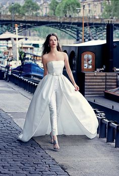 Brides.com: . Silk-satin three-piece pantsuit, $3,750, Rosa Clará. Earrings, price upon request, Mimi So.  Caged booties, $995, Monique Lhuillier.  See more Monique Lhuillier wedding dresses and attire.