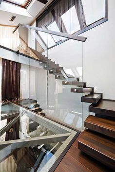 Architects Ion Popusoi and Bogdan Preda collaborated on an amazing residential project – this stunning transparent loft In Brasov, Romania