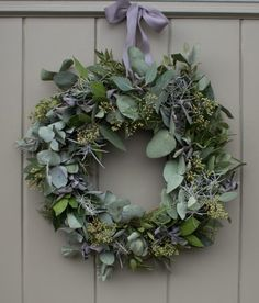 Wreaths are a classic Christmas tradition and they're great fun to make! Here's a list of over 80 beautiful Christmas ideas. Christmas Door Wreaths, Christmas Door Decorations, Christmas Flowers, Christmas Home, Christmas Crafts, Christmas Ornaments, Christmas Reef, Holiday Wreaths, White Christmas