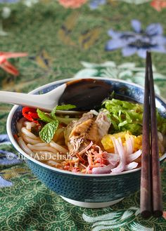 Penang Asam Laksa - spicy-sour fish broth with noodles, voted no 7th out of 50 most delicious food in the world in CNN's poll