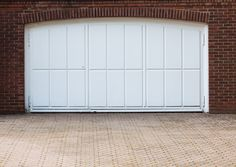 Sleek frosted glass garage door with matching pergola trellis really compliments the brick exterior. Garage Door Panels, Glass Garage Door, Overhead Garage Door, Garage Door Repair, Garage Gate, Glass Doors, Arched Doors, Entrance Doors, Barn Doors