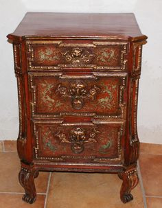 "Rare small Italian #commode with 3 drawers in #polychrome ""oxblood"" wood, old #gold and richly decorated. #Venice, #18th century. For sale on Proantic by Antiquités Lauretta."