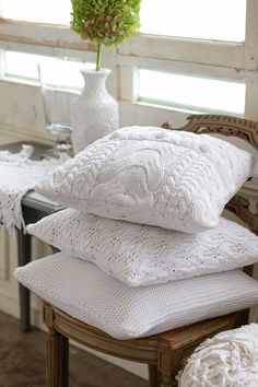 white knitted pillows