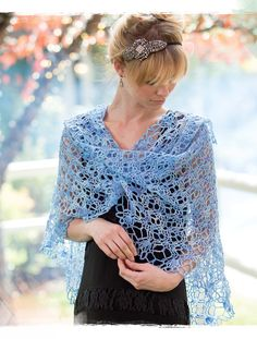As an everyday accessory, this crochet shawl can be worn belted at the waist or wrapped around the neck with the point in front for a fresh, youthful style.