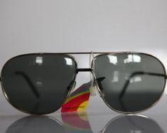Vintage Polaroid Chrome Aviator Frame,   Polarizing Lenses. POLAROID  LOOKERS 4407.  Collectible. Made in France Sunnies, Sunglasses, Vintage Polaroid, Lenses, Eyewear, Casual, Fashion, Moda, Glasses