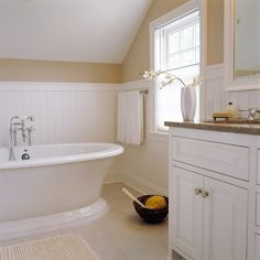 Bathroom with Wainscoting and Angled Ceiling