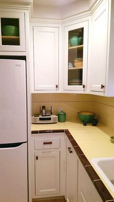 Carolynu0027s Gorgeous 1940s Kitchen Remodel Featuring Yellow Tile With Maroon  Trim