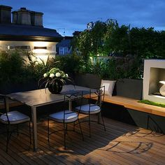 Kensington Roof Garden Terrace by Andy Sturgeon combines timber and planting to the highest level