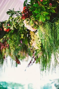 Gotta have photographs of the lush florals! Earthy floral chandelier | Photo by Natasja Kremers
