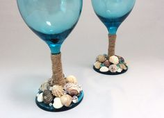 Cheers to our new Sea Breeze Product Line! On top of Aqua-colored glass, artfully placed Sea Shells and Diamonds create our gorgeous seashell sparklers. This set of 13 oz. glasses comes with the stem tied up with small rope, to give the nautical theme a boost. *please note, price does not include customization seen in some photos. Please remember:  Everything in our shop is handmade, Our products do NOT belong in the dishwasher. Handmade = hand wash! Use a soft, damp or soapy towel to wip...
