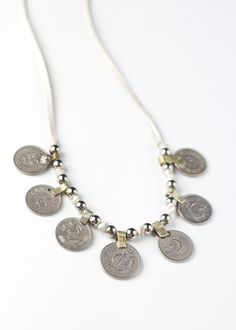 This stunning necklace is handmade with leather lace, silver rounds and antique kuchi coins. It features an adjustable sliding bead back, so it can be worn at your desired length. This beauty could al Coin Jewelry, Coin Necklace, Jewlery, Necklaces, Leather And Lace, White Leather, Grandma Necklace, Big Project, Silver Rounds