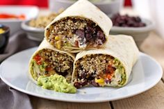Mexican Quinoa Wraps with a sautéed vegetable filling (onion, chilli, red pepper), corn, back beans. Add BBQ sauce, guacamole and sour creme.