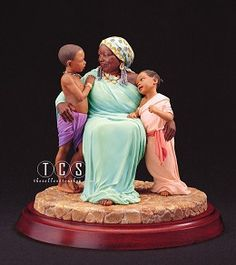 Ebony Visions Grandmama #EbonyVisions #Art. Retired September 2002 with a final production quantity of 11,200. Grandmama's comforting arms encircle two of her young grandchildren as she shares her love and council.