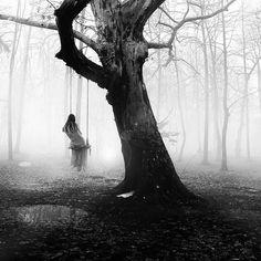 Greek photographer George Christakis | mist | fog | woods | forest | trees | swing | solitude | eerie | swamp |