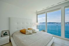 Mallorca Resort Style Villa is a Seafront Paradise Blue Pool, White Upholstered Headboard, White Leather Bed, Master Bedroom Interior, White Interior Design, Villa Design, Waterfront Homes, Am Meer, House Colors