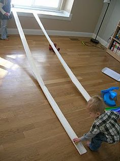 How cool is this! 5 bucks to buy a 10 foot rain gutter and is the perfect size for a matchbox car track! So doing this!