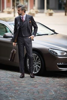 Double breasted waist jacket. Unusual touch. Nice and the car isn't too shabby either...XO Carlos
